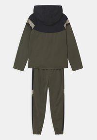 Nike Sportswear - POLY SET UNISEX - Tracksuit - cargo khaki/black/stone/white - 1