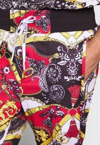 Versace Jeans Couture - TECNO PRINT BELT PAISLE - Tracksuit bottoms - rosso - 5