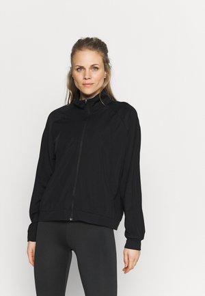 ONPATIFA ZIP TRAIN CURVY - Training jacket - black