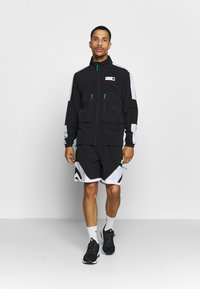 Puma - PARQUET WARM UP - Training jacket - black