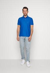 Tommy Hilfiger - REGULAR - Poloshirt - blue - 1
