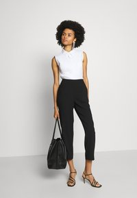Steffen Schraut - CAROL DARLING PANTS - Trousers - black - 1