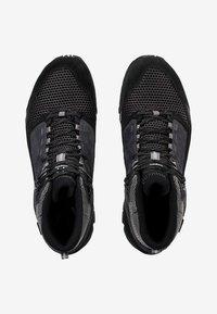 Haglöfs - SKUTA MID PROOF ECO - Hiking shoes - black - 1
