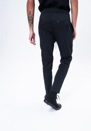 KAB - Tracksuit bottoms - black