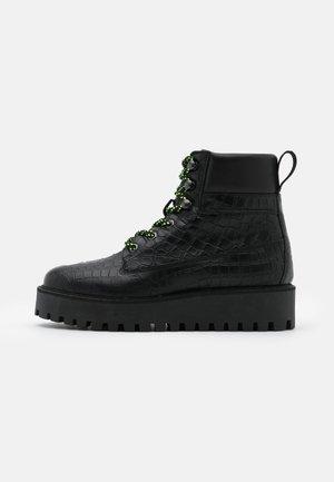 ALASKA - Winter boots - black
