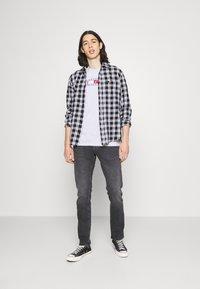 Tommy Jeans - SCANTON SLIM - Jeans slim fit - erno black - 1