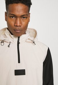 adidas Originals - UNISEX - Windbreaker - halo ivory/black - 3