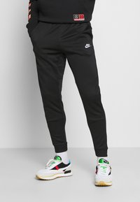 Nike Sportswear - TRIBUTE - Tracksuit bottoms - black/white - 0