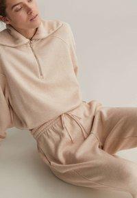 OYSHO_SPORT - Pantalon de survêtement - mottled beige - 5