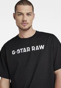 G-Star - FLOCK BOXY R T UNISEX  - Print T-shirt - dry jersey o dk black - 3