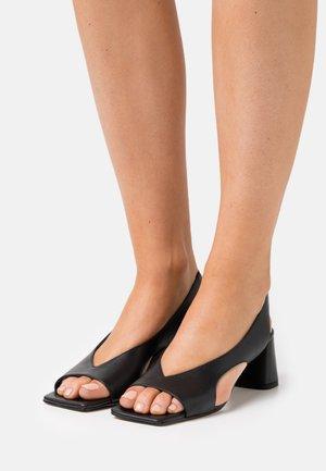 CASIS - Sandales - noir