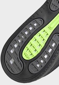 adidas Performance - SUPERNOVA - Neutral running shoes - black - 9