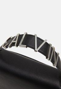 Calvin Klein - FLAP SHOULDER BAG - Handbag - black - 4