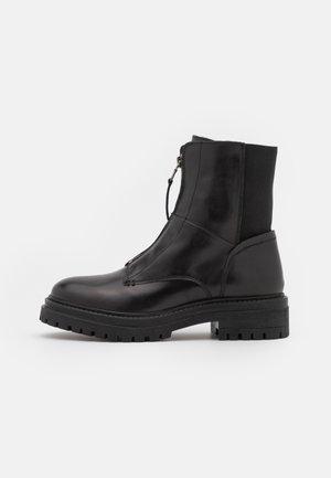 IRIDEA - Classic ankle boots - black