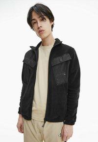 Calvin Klein Jeans - Fleece jacket - black - 0