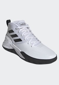 adidas Performance - OWN THE GAME SHOES - Basketball shoes - white/black - 2