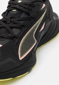 Puma - ULTRARIDE - Neutral running shoes - black/elektro peach/soft fluo yellow - 5