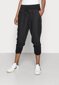 Cream - LINE PANTS - Trousers - solid black - 0