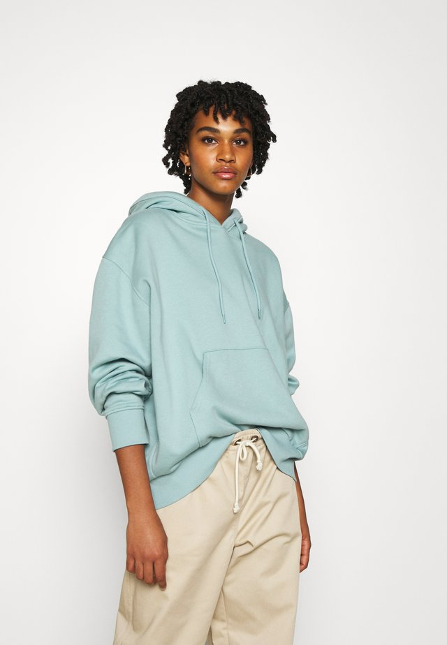 ALISA HOODIE - Jersey con capucha - light green/blue