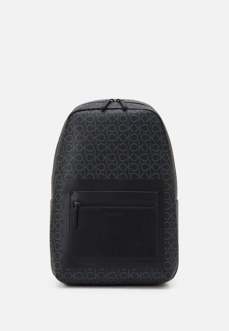 Calvin Klein - ROUND MONO UNISEX - Mochila - black