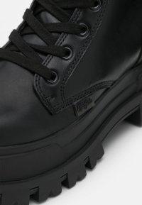 Buffalo - VEGAN ASPHA ON - Platform boots - black - 5