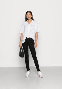 Lee - SCARLETT - Jeans Skinny Fit - black rinse - 1