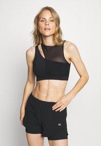 Calvin Klein Performance - MEDIUM SUPPORT BRA - Sujetadores deportivos con sujeción media - black - 0