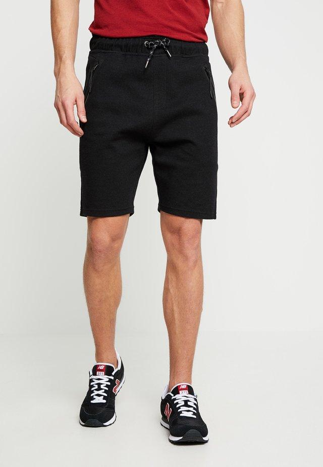 BRAGA - Teplákové kalhoty - black