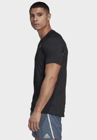 adidas Performance - SUPERNOVA PRIMEGREEN RUNNING SHORT SLEEVE TEE - Print T-shirt - black - 2