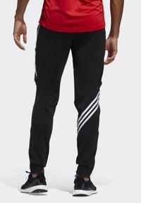 adidas Performance - RUN IT 3-STRIPES ASTRO JOGGERS - Pantalon de survêtement - black - 1