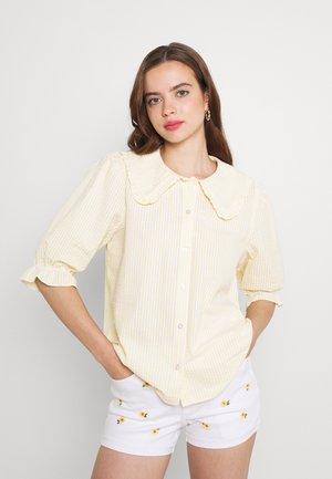 CARRO - Button-down blouse - pale banana