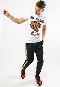 Ed Hardy - CHEETAH-CRYSTAL TRICOT HOTFIX JOGGER - Tracksuit bottoms - black - 0