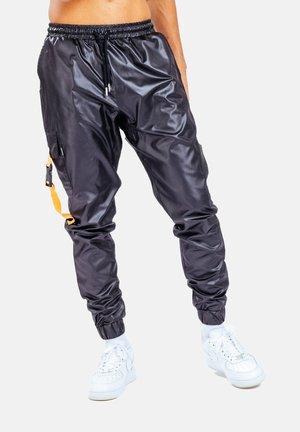Tracksuit bottoms - orange/black