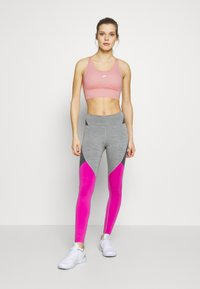 Nike Performance - Sports bra - washed coral - 1