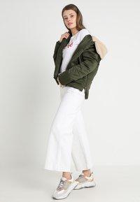 Urban Classics - LADIES SHERPA HOODED JACKET - Winter jacket - dark olive/dark sand - 1