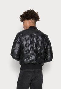 Diesel - THERMO - Down jacket - black - 2