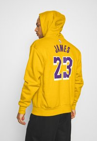 Nike Performance - NBA LOS ANGELES LAKERS LEBRON JAMES CITY EDITION ESSENTIAL - Club wear - amarillo/field purple - 2