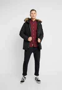 Produkt - HERRY JACKET - Winter coat - black - 1