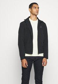 Calvin Klein - CASUAL BLOUSON JACKET - Summer jacket - black - 4