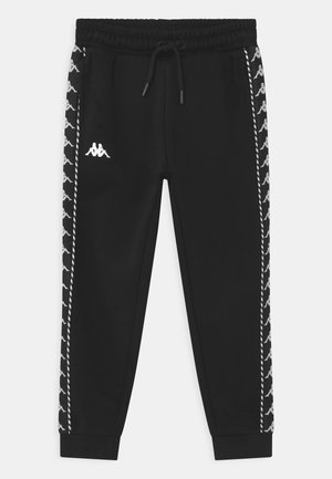 IRENEUS UNISEX - Tracksuit bottoms - black