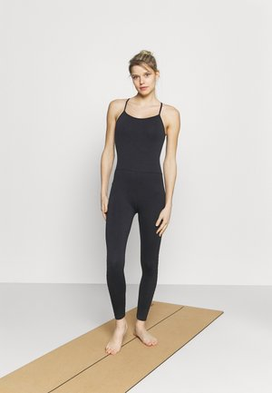 LIFESTYLE SEAMLESS YOGA ONESIE - Gym suit - black