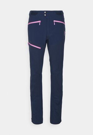 FJØRÅ FLEX PANTS - Trousers - indigo night/violet tulle