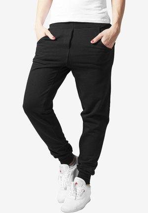 DAMEN - Tracksuit bottoms - black