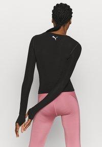 Puma - PAMELA REIF X PUMA COLLECTION RUSHING - Camiseta de deporte - puma black - 2