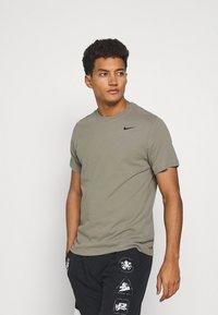 Nike Performance - TEE CREW SOLID - Basic T-shirt - light army/black - 0