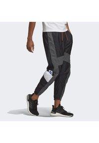 adidas Performance - Tracksuit bottoms - black/black - 2