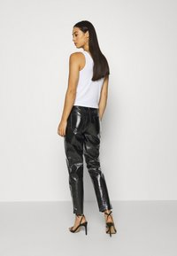 ONLY - ONLEMILY VENYL PANT - Trousers - black - 2