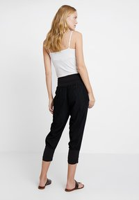 Cream - LINE PANTS - Trousers - solid black - 2