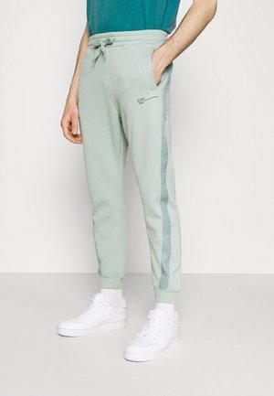 ASTRA WRAP SW PANT - Pantaloni sportivi - blue