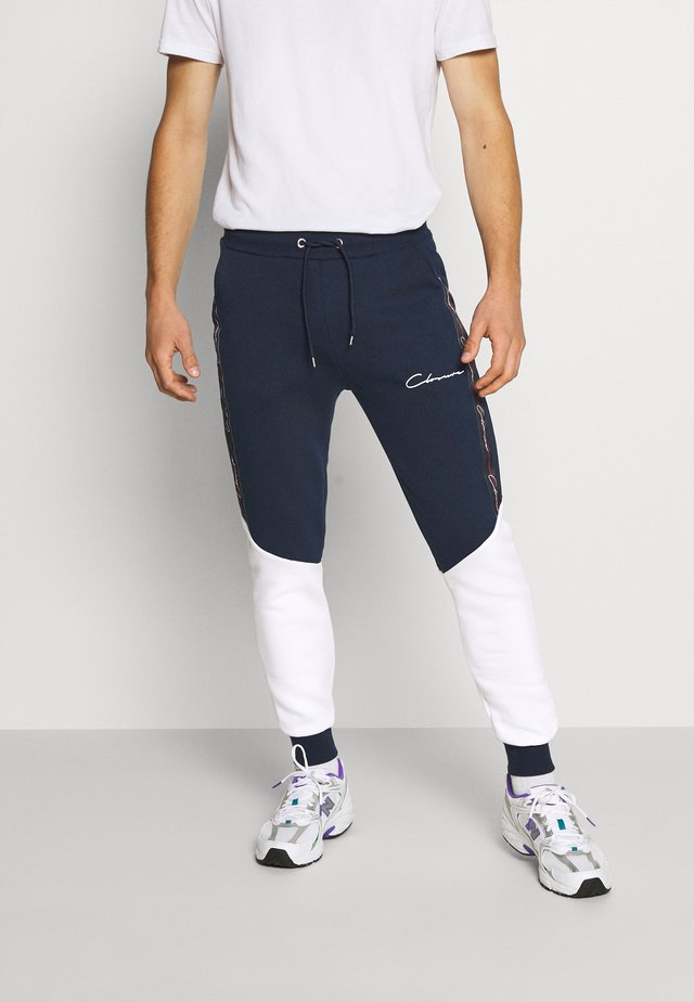 CONTRAST JOGGER WITH TAPING - Verryttelyhousut - navy